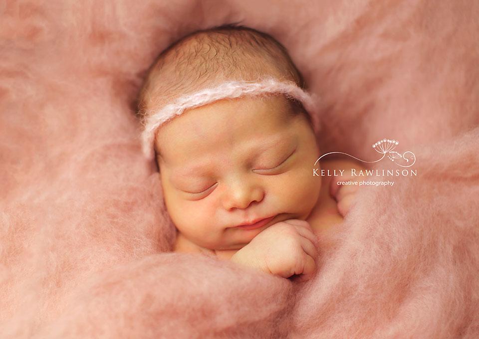 Bradford Newborn Photos.  Baby girl in pink wool.