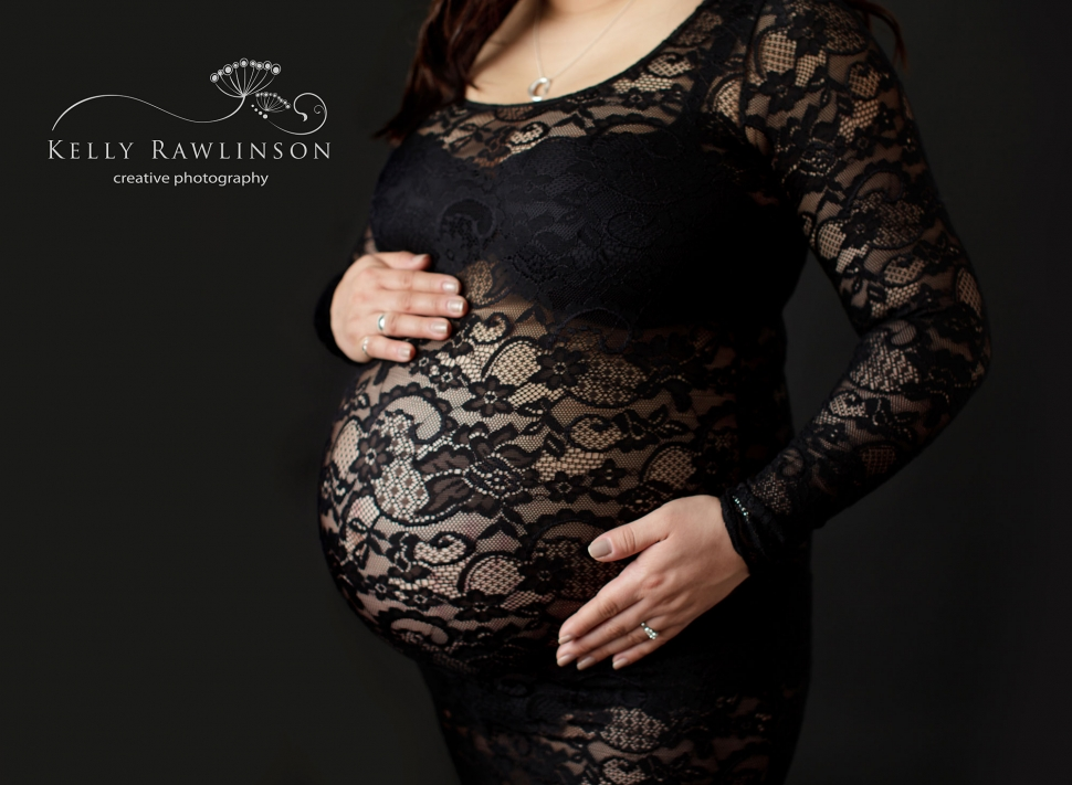 Maternity pictures, mother in black lace dress artistic pregnancy photos