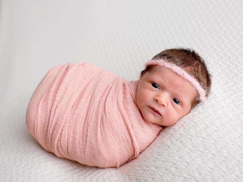 Uxbridge baby girl in jelly bean wrap pose by newborn photographer kelly rawlinson