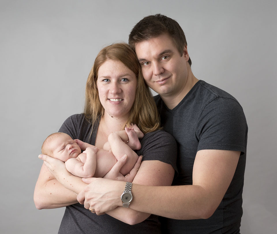 Professional studio photograph, family with newborn girl. Professional photographer near Bradford Ontario capturing memories for new families.